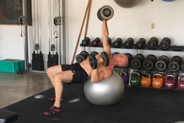 The Alternating Single-Arm Swiss Ball Dumbbell Bench Press